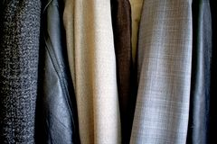 Different clothes placed in the wardrobe. Good texture royalty free stock image