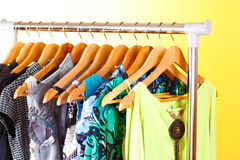 Different clothes on wooden hangers Stock Images