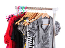 Different clothes on wooden hangers Royalty Free Stock Photos