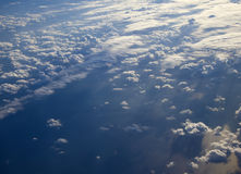 Different clouds below, view from a plane Stock Images
