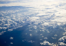 Different clouds below, view from a plane Stock Image