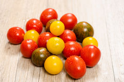 Different cocktail tomatoes in red, orange and green Royalty Free Stock Images