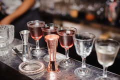Different cocktails or longdrinks in bar stock photo