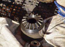Different cog wheels dismantled from the drive line of a car. Stock Photo