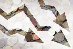 Different coins with negative trends arrows Royalty Free Stock Photo