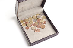 Different coins in open box Royalty Free Stock Photo