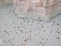 Different coins under water in a fountain Royalty Free Stock Image