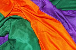 Different colors of cotton. Bulk of color cotton fabrics Stock Image