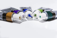 Different color acrylic paints. Acrylic paint tubes on white bcakground Royalty Free Stock Photos