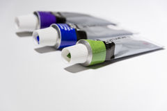 Different color acrylic paints. Acrylic paint tubes on white bcakground Stock Photos