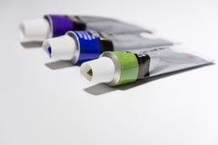 Different color acrylic paints Stock Photos