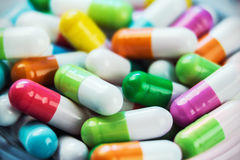 Different color background pills and tablets Stock Image