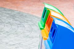 Different Color bins for collection of recycle junk royalty free stock photos