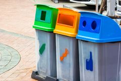 Different Color bins for collection of recycle junk stock image