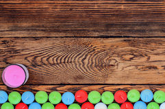 Different color candles on wooden table Stock Photography
