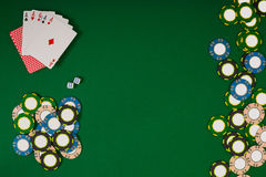 Different color chips for gamblings and playing cards on green Stock Image