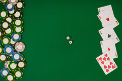 Different color chips for gamblings and playing cards on green Stock Photography