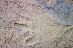 Different color of clay with sand mixure with hay and hand print Stock Image