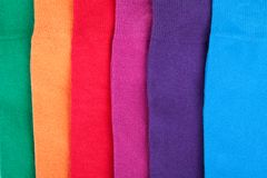 Different color clothes lay in row Royalty Free Stock Photography