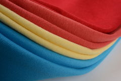Different color cotton cloths folded together Stock Image