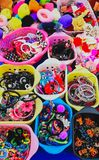 Colorful hair accessories for sale royalty free stock photos