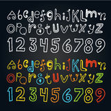 Different color doodle alphabet and numbers Stock Images