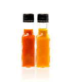 Different color home made hot sauce in glass bottles Royalty Free Stock Photography