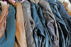 Different color leather jackets next to each other.  Royalty Free Stock Photos