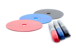 Different color markers and matching cd disks Royalty Free Stock Image