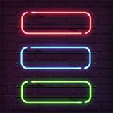 Different color neon frames. Vector realistic neon rectangles on brick wall. Stock Photos