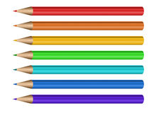 Different color pencils arranged in line on white Stock Photos
