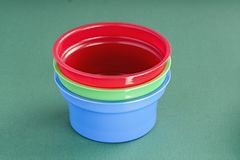 Plastic cups for dairy products. Different color plastic cups for dairy products stock photo