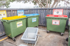 Different color on plastic recycle bins in public park, environmental concept. royalty free stock photos