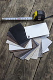Different color samples of wood floor on table Stock Photography