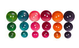 Different color and size round circular shaped sewing buttons in. A row. Creative colorful pattern background high resolution photo Royalty Free Stock Images