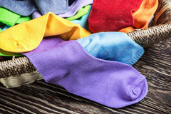 Different color textile socks in the basket Stock Photo