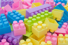Different color toy bricks Stock Images