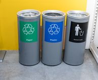 Different color trash cans in row for waste management. stock photography
