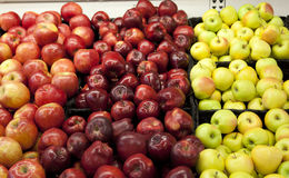 Different colored apples. A variety of apple types and shapes at the supermarket Stock Photo