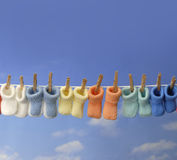 Different colored baby booties on a clothes line Royalty Free Stock Photo