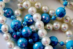 Different Colored Beads On a white background stock image