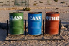 Different Colored Bins. For Collection Of Recycle Materials near Svakopmund desert, place with biggest desert flower welvitchia mirabilis in Namibia royalty free stock images