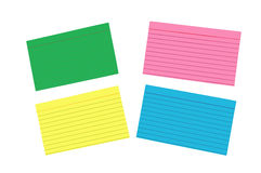 Different Colored Blank Index Cards Isolated. Four brightly colored ruled blank index cards shot horizontally and isolated on a white background Royalty Free Stock Photo