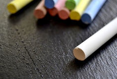 Different colored chalks on a blackboard Stock Photo