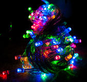 Different colored christmas lights. Red, blue, green and orange colored led christmas lights in night Royalty Free Stock Images