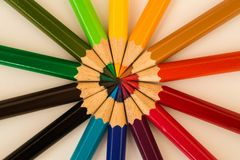 Cololed pencils lying in a circle royalty free stock images