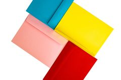 Different colored envelopes on the table. Multi colored envelopes royalty free stock images