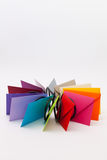 Different colored envelopes on the white desk Royalty Free Stock Photos