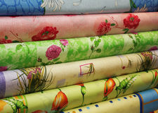 Different colored fabric in rolls Stock Photography