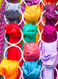Different colored fabrics. Abstract background of different colored fabric materials Stock Photos